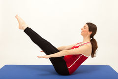 The woman is exercising on a mat Royalty Free Stock Photography