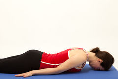 The woman is exercising on a mat Stock Images