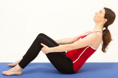 The woman is exercising on a mat Royalty Free Stock Image