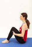 The woman is exercising on a mat Stock Image