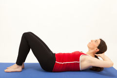 The woman is exercising on a mat Stock Photography