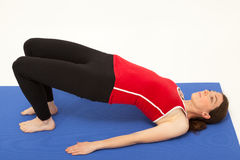 The woman is exercising on a mat Royalty Free Stock Photo