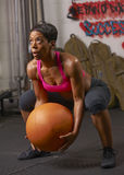 Woman Exercising With Medicine Ball Stock Photos