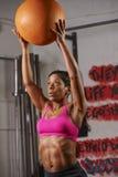 Woman Exercising With Medicine Ball Stock Photos