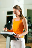 Woman exercising with modern key system Stock Image