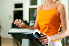 Woman exercising with modern key system Stock Images