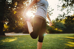 Woman exercising in the morning at city park Stock Photography