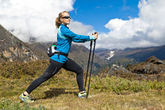 Woman exercising in mountains Royalty Free Stock Images