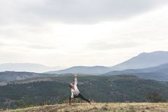 Woman is exercising in mountains stock photos
