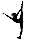 Woman exercising Natarajasana dancer pose yoga silhouette Stock Images
