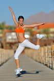 Woman exercising outdoor in summer Stock Images