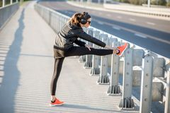 Woman exercising outdoors on the bridge royalty free stock photography