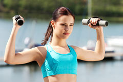 Woman exercising outdoors Royalty Free Stock Photo