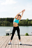 Woman exercising outdoors Stock Images
