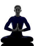 Woman exercising Padmasana lotus pose yoga silhouette Stock Photos