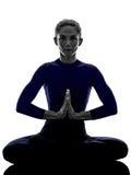 Woman exercising Padmasana lotus pose yoga silhouette. Shadow white background stock photos