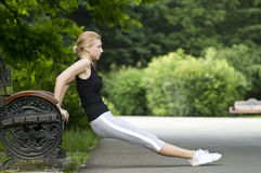 Woman exercising in park Stock Image