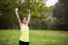 Woman exercising at the park Royalty Free Stock Photos