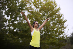 Woman exercising at the park Stock Photo