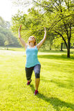 Woman exercising in park Royalty Free Stock Photos