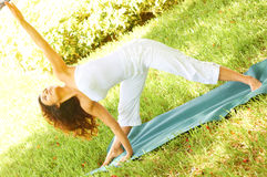 Woman Exercising In Park Stock Images