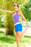 Woman Exercising In Park Royalty Free Stock Photography