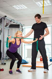 Woman exercising with personal trainer Royalty Free Stock Image