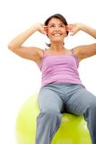 Woman exercising with a pilates ball Royalty Free Stock Photo