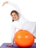 Woman exercising on a pilates ball Royalty Free Stock Image