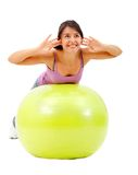 Woman exercising with a pilates ball Royalty Free Stock Images
