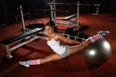Woman exercising Pilates ball Royalty Free Stock Images