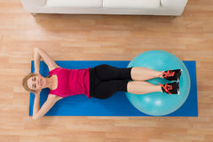 Woman Exercising With Pilates Ball Royalty Free Stock Photography