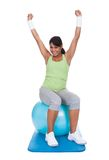 Woman Exercising On Pilates Ball Stock Photography