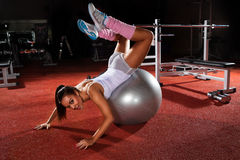 Woman exercising Pilates ball Royalty Free Stock Image
