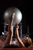 Woman exercising Pilates ball Stock Photography