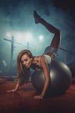 Woman exercising Pilates ball  Royalty Free Stock Photos