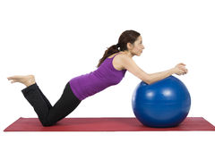 Woman exercising with a pilates ball Royalty Free Stock Image
