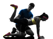 Woman exercising plank position fitness workout with man coach