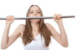 Woman exercising on pull-up bar Royalty Free Stock Photo