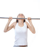 Woman exercising on pull-up bar Stock Image