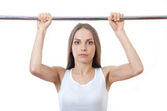 Woman exercising on pull-up bar Royalty Free Stock Photos