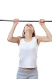 Woman exercising on pull-up bar Stock Photography
