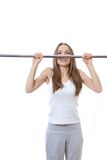 Woman exercising on pull-up bar Stock Photos