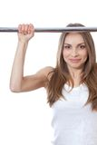 Woman exercising on pull-up bar Royalty Free Stock Image