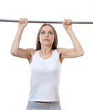 Woman exercising on pull-up bar Stock Images