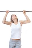 Woman exercising on pull-up bar Royalty Free Stock Images
