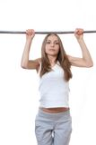 Woman exercising on pull-up bar Stock Photo