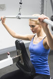 Woman Exercising On Pulley At Gym Royalty Free Stock Images