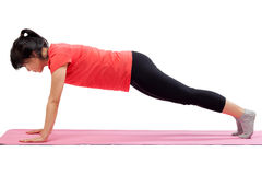 Woman exercising with push up pose Stock Photos