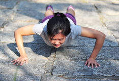 Woman exercising pushups Stock Image